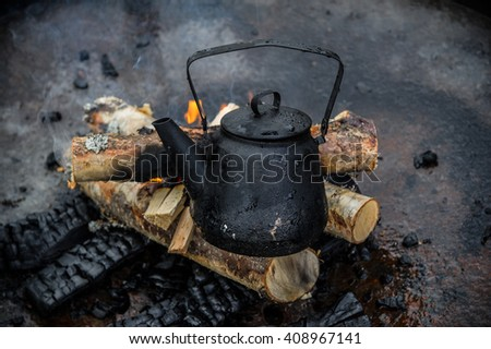 kettle on campfire - stock photo
