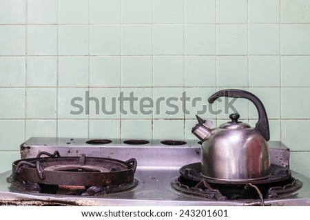 kettle on the gas stove - stock photo