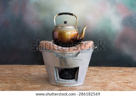 Kettle on the stove, Still life style - stock photo