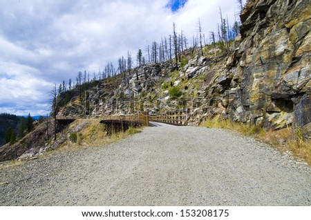 Kettle Valley Railway trail. Myra Canyon is a popular tourist attraction featuring a cycling and hiking trail following the historical route of the Kettle Valley Railway.  - stock photo