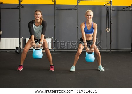 kettlebell fitness training woman in a gym