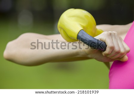 Kettlebell training fitness woman - stock photo