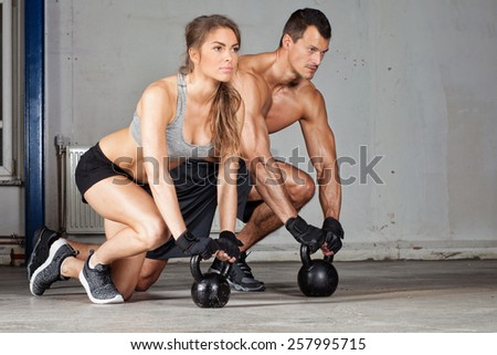 kettlebell training man and woman - stock photo