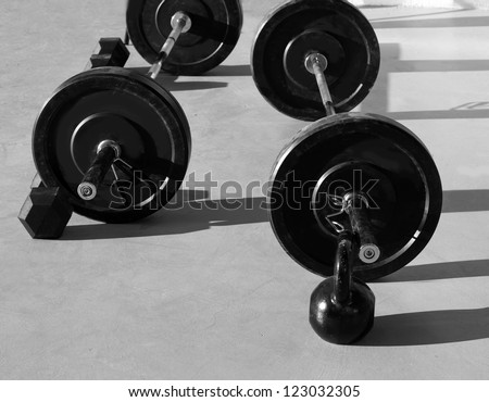 Kettlebells at gym with lifting bar weights fitness equipment - stock photo