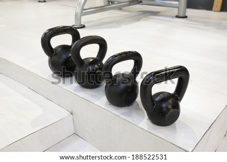 Kettlebells in a gym - stock photo