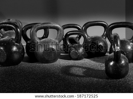 Kettlebells weights in a workout gym in black and white - stock photo