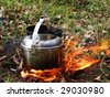 kettles on an open fire - stock photo
