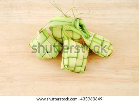 Ketupat is a local delicacy during the festive season in South East Asia. Ketupat, a natural rice casing made from young coconut leaves for cooking rice. - stock photo