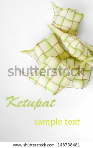 Ketupat on white background. Ketupat is traditional food in Malaysia - stock photo