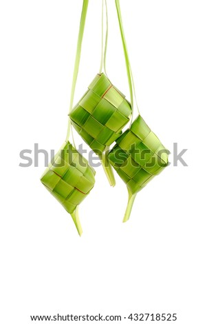 Ketupat or rice dumpling is a local delicacy during the festive season. Ketupat, a natural rice casing made from young coconut leaves for cooking rice on a white background. - stock photo