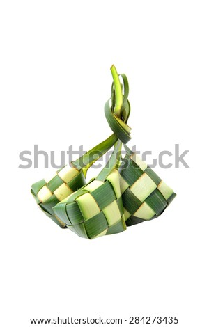 Ketupat or rice dumpling is a local delicacy during the festive season. Ketupats, a natural rice casing made from young coconut leaves for cooking rice on white background - stock photo