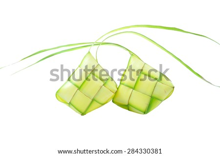Ketupat or rice dumpling is a local delicacy during the festive season.   Ketupats, a natural rice casing made from young coconut leaves for cooking rice on a white background - stock photo