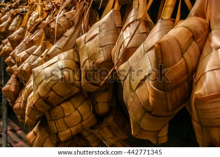 Ketupat (rice dumpling) is a local delicacy during the festive season in Malaysia. It is a natural rice casing made from young coconut leaves for cooking rice during Hari Raya Aidilfitri or Aidiladha. - stock photo