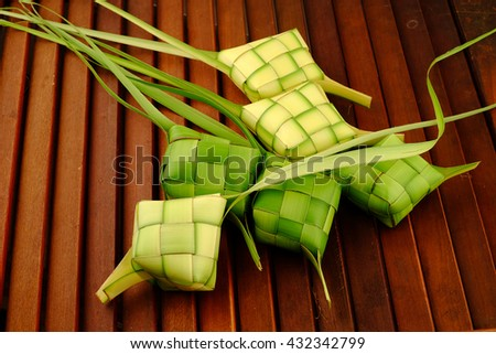 Ketupat (Rice Dumpling) On Black Background. Ketupat is a natural rice casing made from young coconut leaves for cooking rice during eid Mubarak.