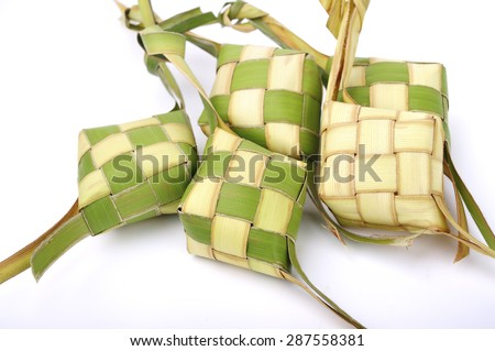 Ketupat (Rice Dumpling) On White Background. Ketupat is a natural rice casing made from young coconut leaves for cooking rice during eid Mubarak  - stock photo