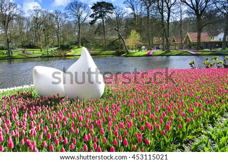 KEUKENHOF, NETHERLANDS - APRIL 7: The sculpture in park of Keukenhof on April 7, 2016. This place is the world's largest flower garden stayed in Lisse, The Netherlands. - stock photo