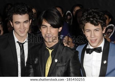 Kevin Jonas, Joe Jonas, Nick Jonas at JONAS BROTHERS THE 3D CONCERT EXPERIENCE Premiere, El Capitan Theatre, Los Angeles, CA 2/24/2009 - stock photo