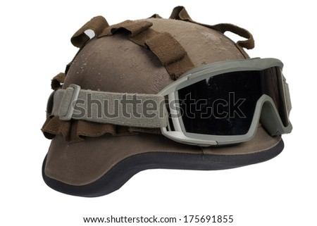 kevlar helmet with camouflage cover and protective goggles