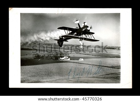 stock-photo-kewanee-il-circa-lloyd-h-stoner-standing-on-wing-of-inverted-biplane-flown-by-marion-f-45770326.jpg