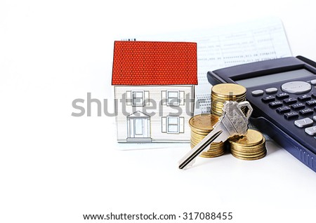 key and coins stack with calculator and paper house with saving passbook - stock photo