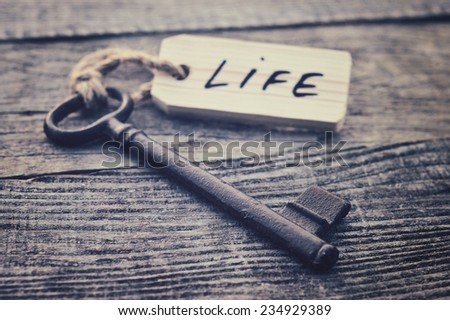 Key and label. Life concept - stock photo