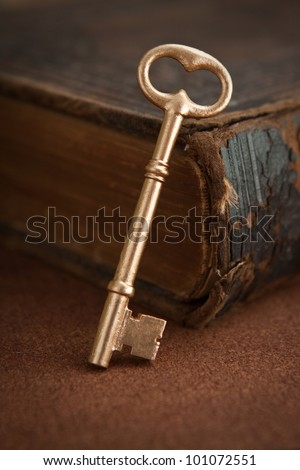 Key and old book - stock photo