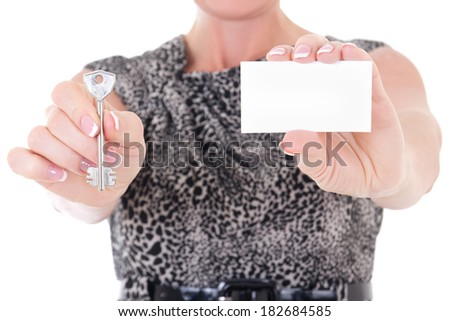 key and visiting card in female hands isolated on white background - stock photo