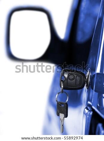 Key at car doors - close up with shallow DOF - stock photo