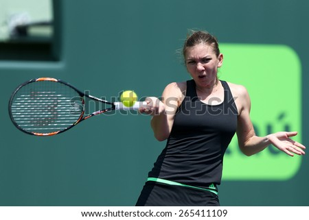 KEY BISCAYNE, FL-MAR 27: Simona Halep of Romania returns a shot during day five of the Miami Open at Crandon Park Tennis Center on March 27, 2015 in Key Biscayne, Florida. - stock photo