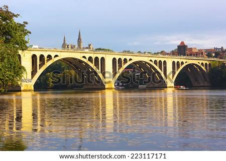 Key Bridge at sunrise with Georgetown University in sight, Washington DC. Francis Scott Key Bridge in Washington DC, USA - stock photo