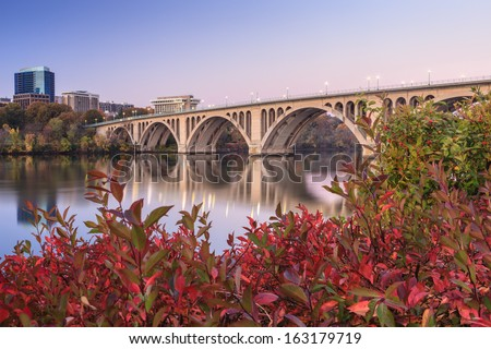 Key Bridge in autumn over the Potomac River connecting Rosslyn, Arlington County, Virginia to Georgetown, Washington, DC. - stock photo