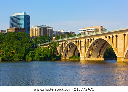 Key Bridge in Washington DC with office building on background. The bridge photographed from Georgetown Park in early summer morning. - stock photo