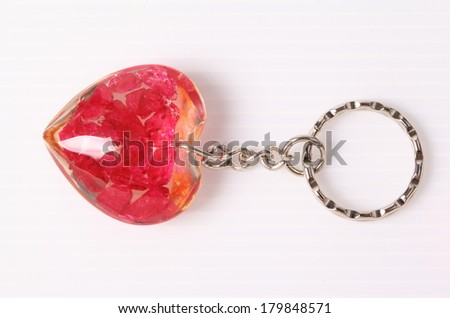 Key chain heart shape with gemstones isolated on white background
