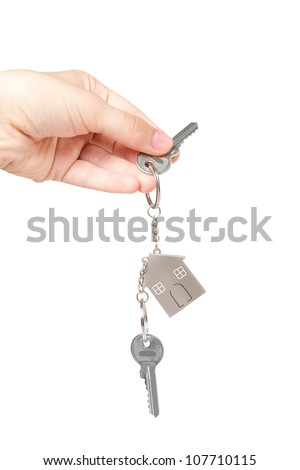key chain in hand on a white  background - stock photo
