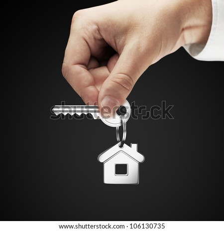 key chain with key in hand man - stock photo