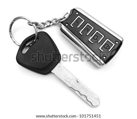 Key from the car and a charm. On a white background. - stock photo