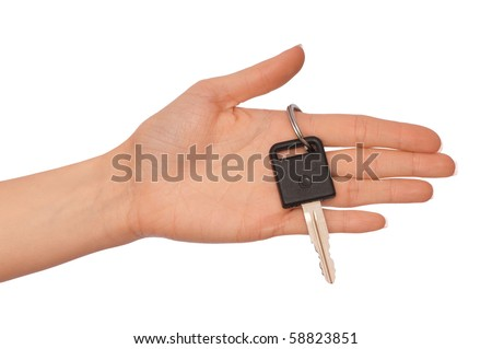 Key from the new house in hands of the woman