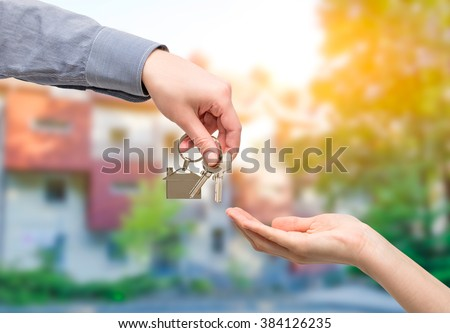 key home buy sale hand business owner estate real house - stock image - stock photo