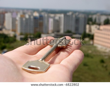 Key in a hand on a background building - stock photo