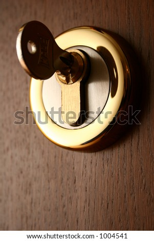 Key in a lock in a door - stock photo