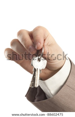 key in businessman's hands - stock photo