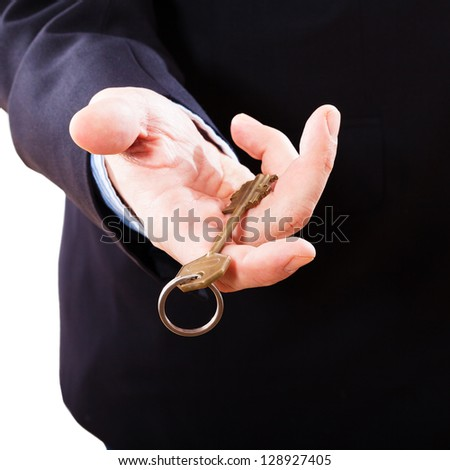 Key in hand businessman. Concept of buying real estate - stock photo