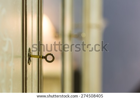 Key in the door lock - stock photo