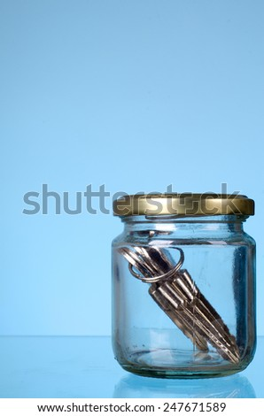 Key in the jar: The concept of 'Key of success' - stock photo