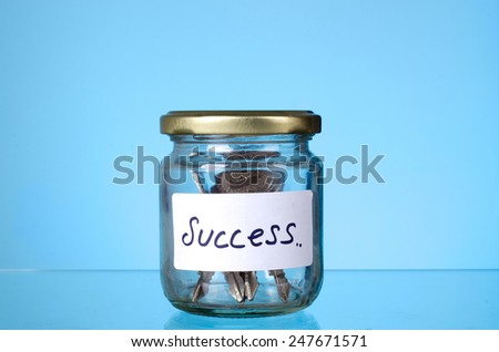 Key in the success jar: The concept of 'Key of success' - stock photo