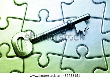Key on jigsaw puzzle - stock photo
