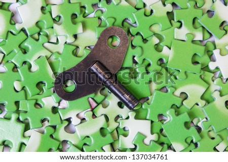 key on pile of green puzzle