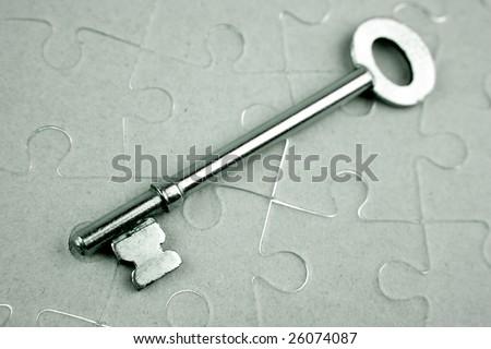Key on puzzle - stock photo