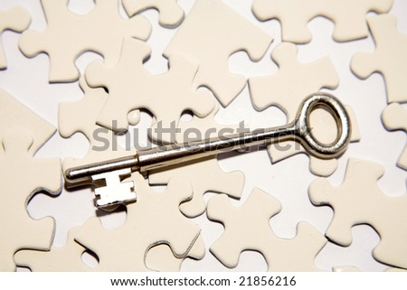 Key on puzzle pieces - stock photo