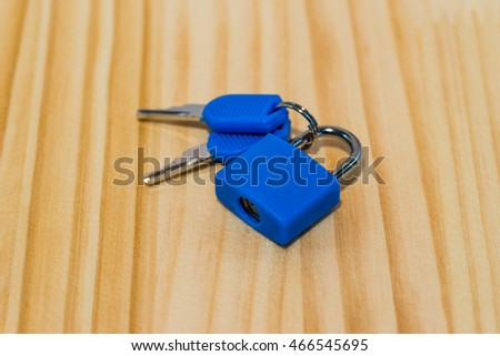 Key on wooden background